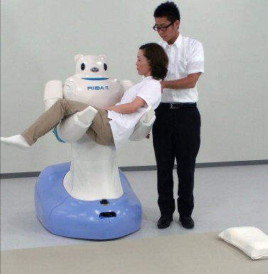 Japanese robots transfer patient from bed to wheelchair