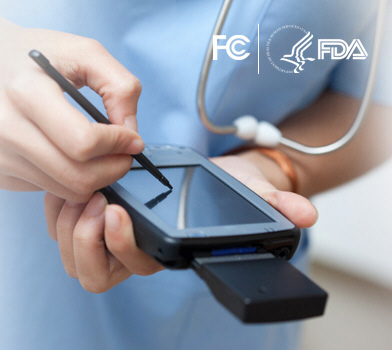 imag of health care practitioner with handheld mobile device
