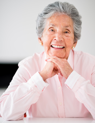 Portrait of a beautiful senior woman smiling at home